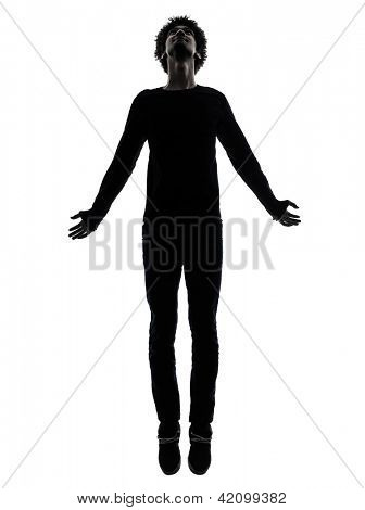 one african handsome young man jumping   in silhouette studio isolated on white background