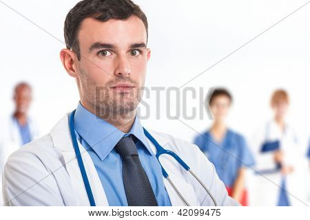 Portrait of a doctor in front of his medical team