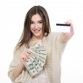 Cheerful attractive young lady holding cash with plastic card and happy smiling over white backgroun
