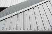 picture of gable-roof  - Architectural detail of metal roofing on commercial construction of modern building complex - JPG