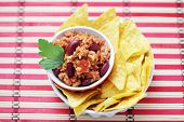delicious chili con carne with tortilla chips - food and drink
