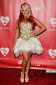 LOS ANGELES - FEB 8:  Bonnie McKee arrives at the 2013 MusiCares Person Of The Year Gala Honoring Br