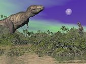 stock photo of tyrannosaurus  - Tyrannosaurus dinosaurs in prehistoric landscape by night - JPG