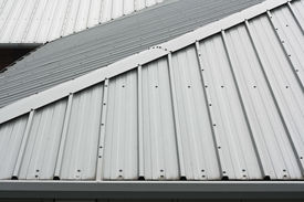 image of gable-roof  - Architectural detail of metal roofing on commercial construction of modern building complex - JPG