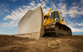 image of bulldozers  - A large yellow bulldozer at a construction site low angle view - JPG