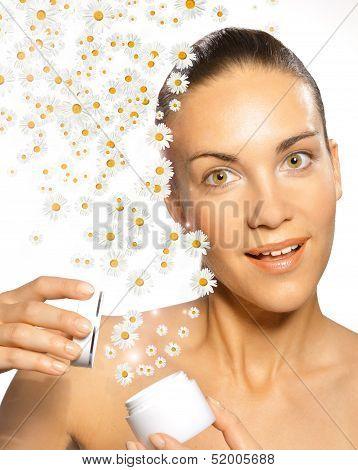 Woman with white chamomile cream