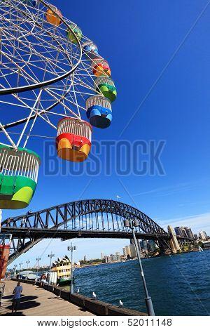 Ferris Wheel And Sydney Harbour Bridge, Australia