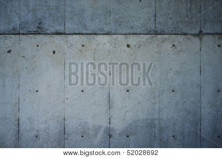 Bare concrete wall, shot with panel seam lines perpendicular to image dimension.