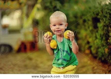 child with lemons