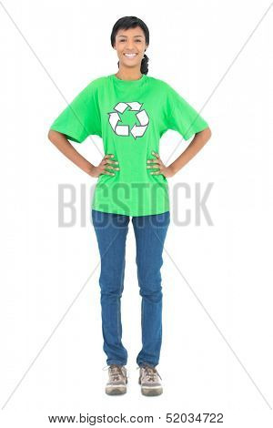 Smiling black haired ecologist posing with hands on the hips on white background