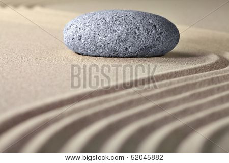 stone sand zen garden raked sand and pebble abstract for balance calmness spiritual and tranquil rippled pattern texture and lines background