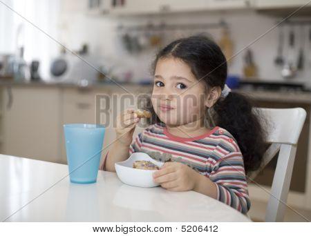 Little Girl Having Her Breakfast.