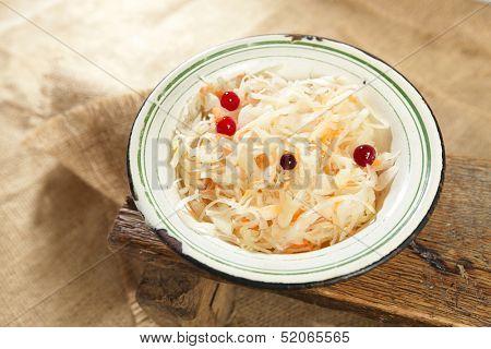 sauerkraut - Sour cabbage -  old enamel bowl