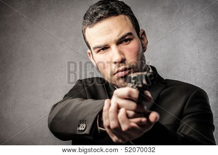 young man with gun in hand