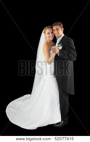 Happy young married couple dancing viennese waltz smiling at camera
