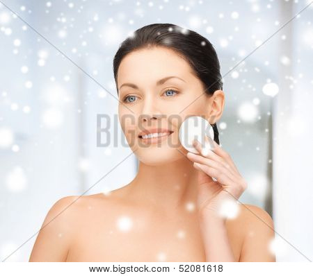 health and beauty concept - beautiful woman with cotton pad