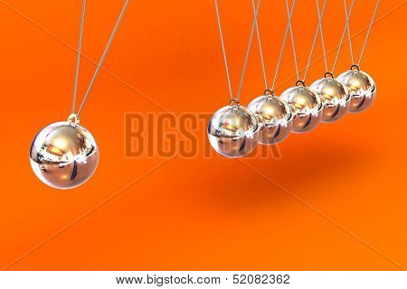 Newtons Cradle On A Orange Background