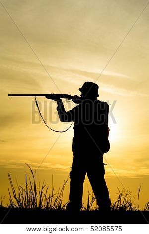 Hunter With Shotgun in Sunset