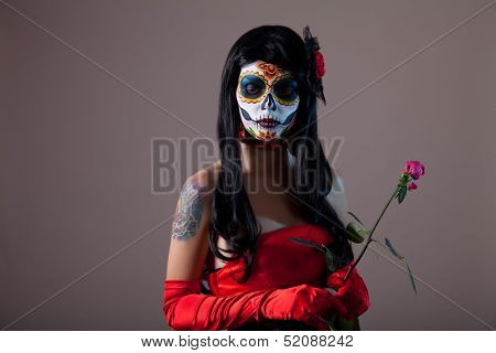 Sugar skull girl with red rose, Halloween shot