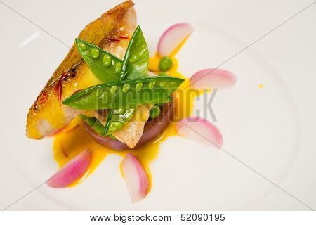 White fish fillet in sauce with radish and pies
