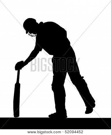 Sport Silhouette - Cricket Batsman Checking Pitch