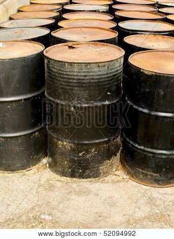 Rows Of Rusting Black Drums