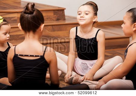 Girls warming up in dance class