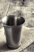 image of chalice antique  - old metal cup on wooden table close up