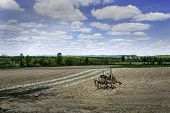 foto of sulky  - An antique sulky plow sits in a farm land near Palatine Bridge New York - JPG