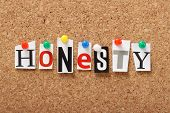 stock photo of honesty  - The word Honesty in cut out magazine letters pinned to a cork notice board - JPG