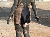 picture of mud pack  - lady at dead sea wearing therapeutic mud pack - JPG