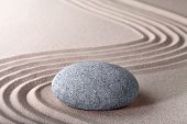stock photo of zen  - zen garden japanese garden zen stone with raked sand and round stone tranquility and balance ripples sand pattern - JPG