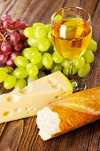 Wine, grapes and cheese still life