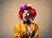 image of clown face  - portrait of a beautiful clown screaming - JPG