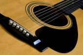 stock photo of polly  - The bridge and strings of and acoustic guitar - JPG