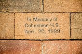 stock photo of columbine  - A bick in a sidewalk in Denver in memory of the Columbine High School shooting in Arip of 1999 - JPG