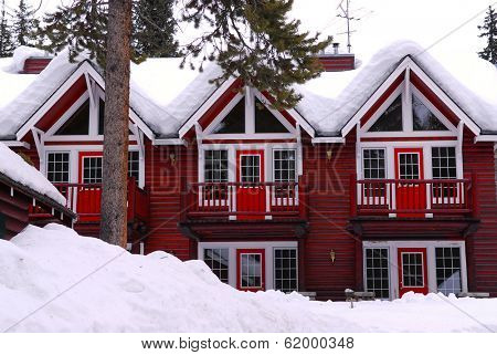 Log building of a mountain lodge in winter at ski resort