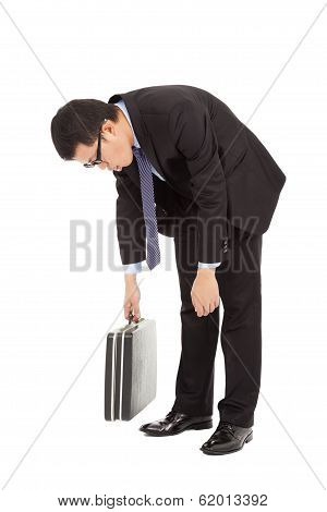 Very Tired Businessman Stoop And Holding Briefcase