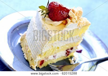 Slice of strawberry meringue cake on a plate