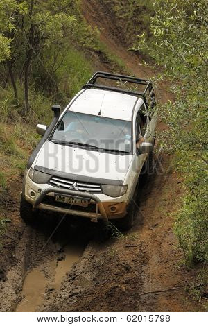 White Mitsubishi Triton Dhd Crossing Mud Obstacle