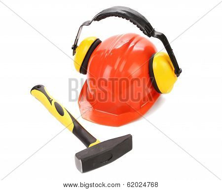Ear muffs on hard hat and hammer.