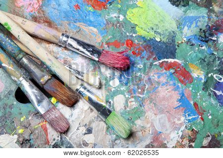 Colorful Palette And Paint Brushes