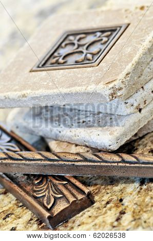 Ceramic tiles and borders for backsplash close up on a granite surface