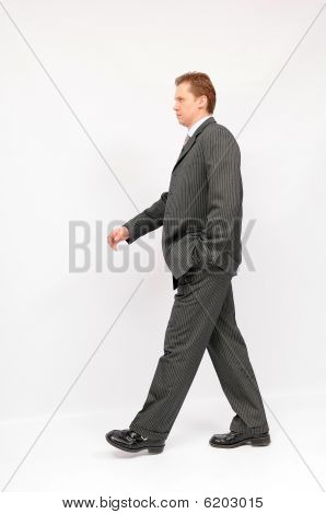 Young walking businessman