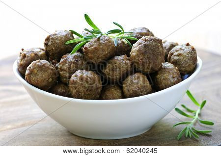 Fresh hot meatball appetizers served in white bowl