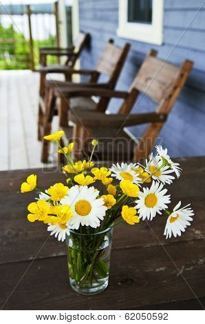 Bouquet of wildflowers on a rustic table at country cottage