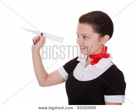 Beautiful Flight Attendant With Paper Aeroplane
