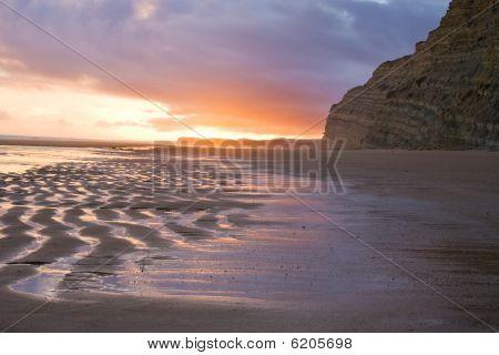 Sunset reflection on Sandy beach