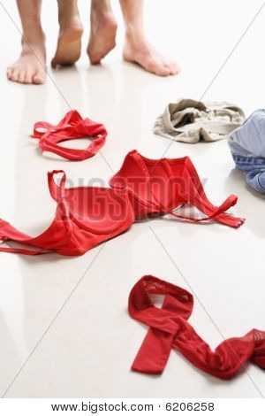 Couple Having Intercourse With Red Underwear On Floor