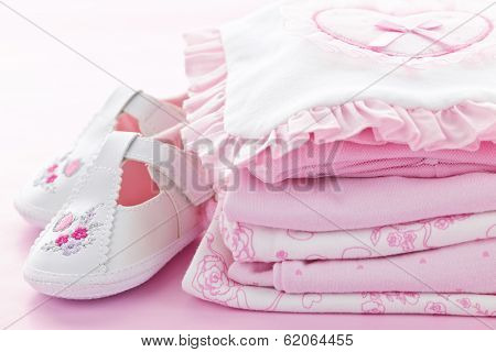 Pink infant girl clothing and shoes for baby shower